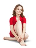 Sitting girl in red dress Stock Image