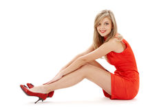 Sitting girl in red dress Royalty Free Stock Photo