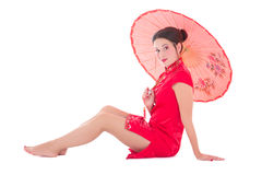 Sitting girl in red japanese dress with umbrella isolated on whi Stock Image