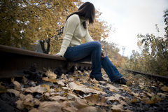 Sitting girl on a tracks Stock Photos