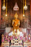 Sitting gold buddha statue Stock Photos