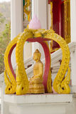 Sitting golden buddha statue in front of the church . Stock Images