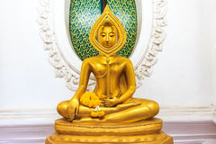 Sitting Golden Buddha statue in Thai Buddhist Temple Stock Images