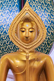 Sitting Golden Buddha statue in Thai Buddhist Temple Stock Image