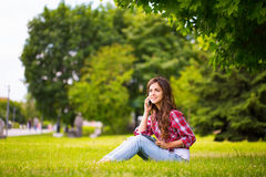 Sitting at the grass in park. Stock Photography