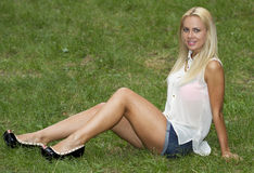 Sitting on grass in park Stock Images