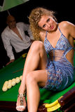 Sitting on green snooker table stock image