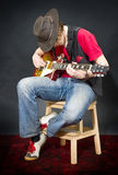 Sitting Guitar player Royalty Free Stock Photo