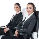 Sitting with headsets on Stock Images