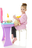 Sitting at Her Hairdressing Station Stock Photo