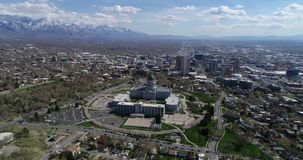 Aerial of Utah's state capitol building overlooking downtown Salt Lake City. Sitting high on the hill above downtown Salt Lake City, Utah's capitol building stock video footage