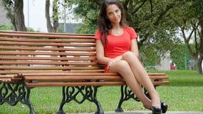 Sitting Hispanic Female Stock Image
