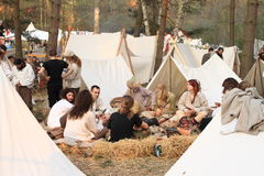 Sitting in historical camp Stock Photos