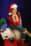 Sitting with Holiday packages Royalty Free Stock Photography