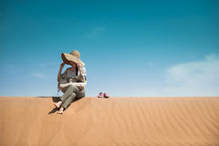 Sitting In Desert Royalty Free Stock Images