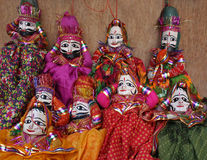 Sitting Indian puppets Royalty Free Stock Photos