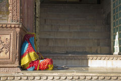 Sitting indian woman in colorful sari Stock Images