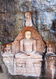 Sitting Jain figures carved out of Gwalior's Rock in India. Stock Photo