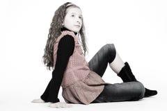 Sitting kid stock images