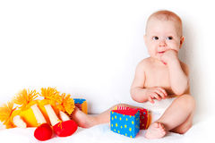 The sitting kid with toys Stock Photo