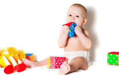 The sitting kid with toys Stock Image