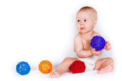 The sitting kid with toys Royalty Free Stock Photo