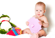 The sitting kid with toys Stock Photography