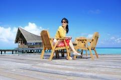 Sitting lady Stock Images