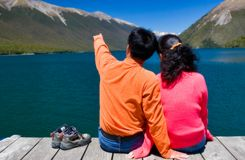Sitting by the lake. A couple sitting by the lake, New zealand Stock Photo