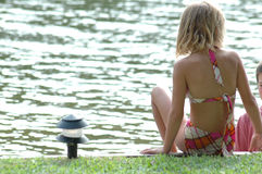 Sitting by the lake stock photography