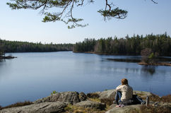 Sitting by the lake Royalty Free Stock Photos