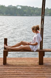 Sitting by Lake Stock Photo