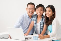 Sitting at the laptop Royalty Free Stock Photo