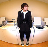 Sitting on a laundry machine Stock Photo