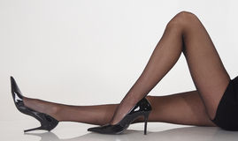 Sitting Legs in Pantyhose and Black Heels Royalty Free Stock Photo