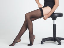 Sitting Legs in Pantyhose and Black Heels Stock Photos
