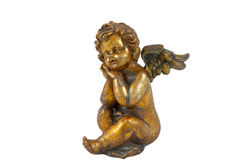 Sitting little angel. Small firurine of golden little angel Stock Images