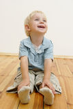 Sitting little boy Royalty Free Stock Images