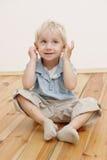 Sitting little boy Stock Photos