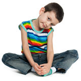 Sitting little boy in striped shirt Stock Images