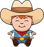 Sitting Little Cowboy Stock Image