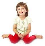 Sitting little girl Royalty Free Stock Image