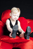 Sitting little girl Royalty Free Stock Images