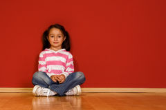 Sitting little girl Stock Photos