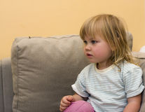 Sitting little girl with blond hair Royalty Free Stock Photo