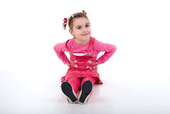 Sitting Little Girl In Pink. Royalty Free Stock Photos