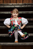 Sitting little girl in traditional costume Royalty Free Stock Photos