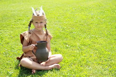 Sitting little indian girl with pitcher Stock Photography
