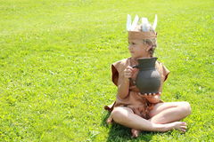 Sitting little indian girl with pitcher Royalty Free Stock Photo