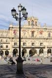 Sitting in Main Square. SALAMANCA, SPAIN - FEBRUARY 5, 2013: People sitting in the main square. The Plaza Mayor of Salamanca, Spain, is an urban square built as Stock Images